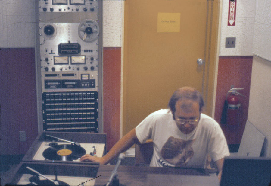 Dave Wigfield at KCHO Studio with Sparta Centurian Cart Machines and Crown 700 Tape Machines in Background